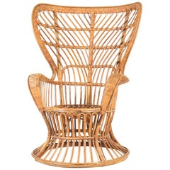 Italian Mid-Century Modern Rattan Wingback Chair by Lio Carminati for Bonacina
