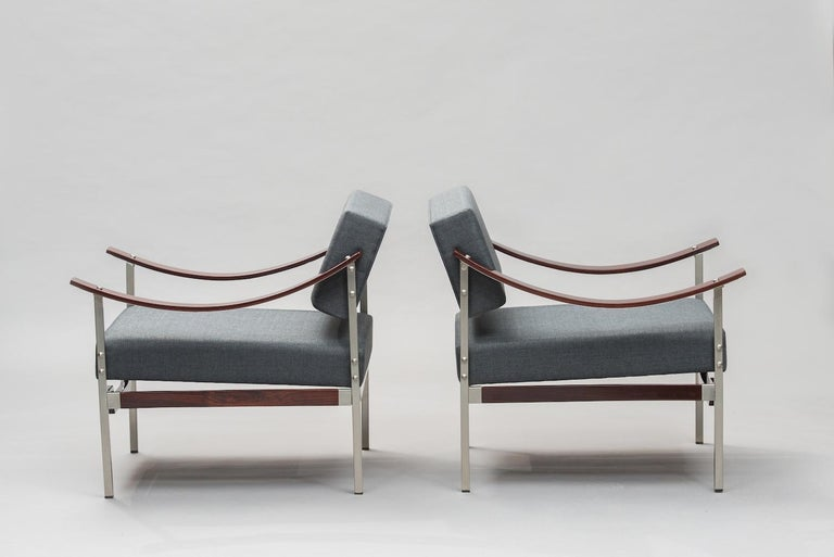 Italian Mid-Century Modern rosewood and chrome armchairs reupholstered in grey fabric.