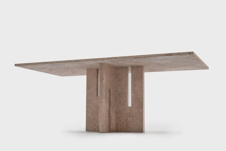 Impressive travertine dining table in the style of Carlo Scarpa, Italy, 1970s. The table is fully made of Italian travertine with a beautiful pattern. The 3 cm thick travertine top lays on an architectonic base made of 4 cm thick travertine. Very