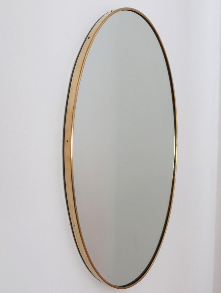 Beautiful Italian midcentury wall mirror with original brass frame.