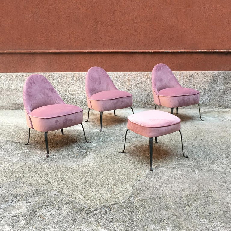 Italian midcentury purple velvet and metal legs armchairs, 1950s Set of three armchairs and a pouf from 1950s, with fully padded seat covered with a new pink velvet and with curved metal legs. Very good condition. Measures: Armchair 58 x 65 x 75