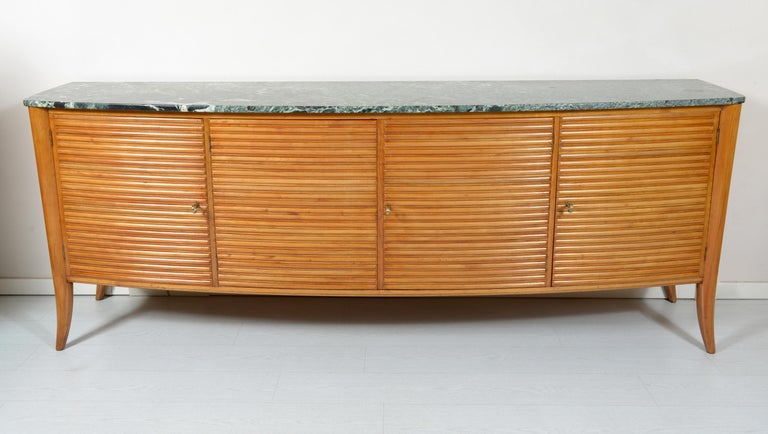Sideboard with rounded shape in solid grooved cherrywood, four doors with internal shelves. Luxurious