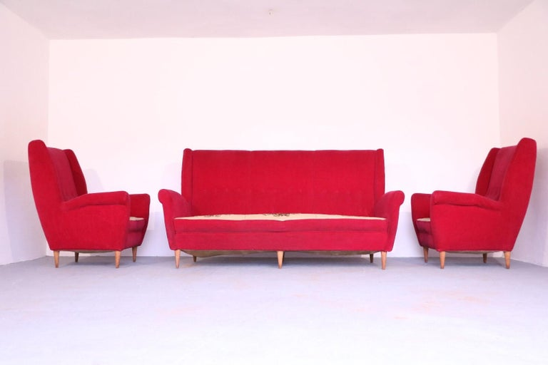 Elegant, stunning living room set by Gio Ponti for Editions ISA, Bergamo, 1955 including a pair of Italian Mid-Century Modern armchairs or lounge or wingback or high back chairs and a sofa / couch.   Featuring high backs, a sculpted profile,