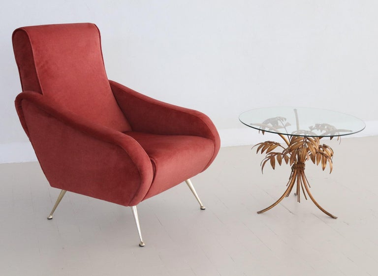 Beautiful, elegant and comfortable Italian vintage armchair, original from the 1950s. The armchair have been restored completely internally with high quality material and reupholstered with lobster/salmon colored super soft easy-care velvet.  Very