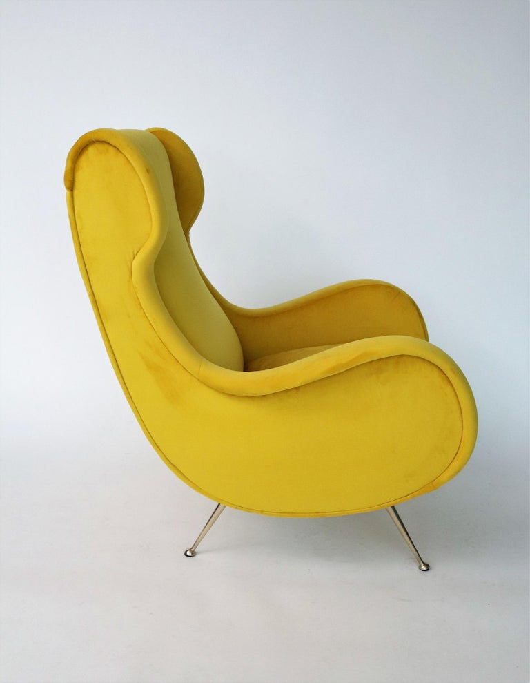 Magnificent, beautiful Italian original midcentury armchair or lounge chair from the 1950s with full brass feet. Completely restored internally with quality material and outside reupholstered with soft sunny yellow Italian velvet. This exceptional