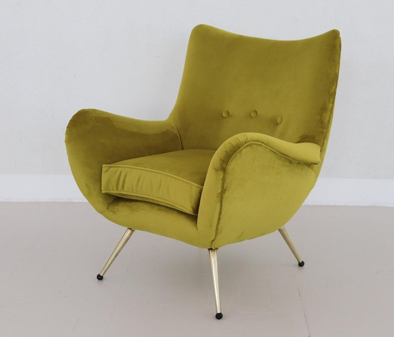 Beautiful, elegant and comfortable Italian vintage armchair, original from the 1950s. The armchair have been restored completely internally with high quality material and reupholstered with lime, green colored soft Italian velvet. Legs are made of