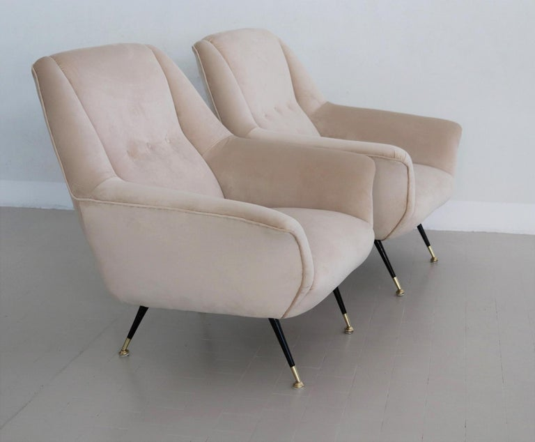 Elegant and beautiful pair of Italian original midcentury armchairs or lounge chairs from the 1950s with brass feet. Completely restored internally with quality material and outside reupholstered with soft light beige - taupe Italian velvet. Signs
