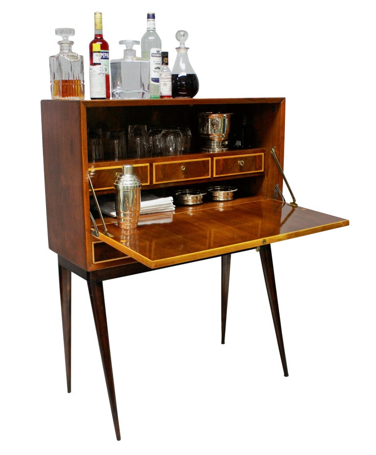 An Italian bar cabinet of stylish design, with drawers inside and two drawers beneath, all with their own key. In cherrywood and box wood.