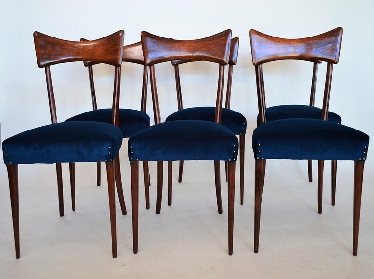 Beautiful set of six Italian midcentury dining chairs, made in the style of Ico Parisi during the 1950s. The chairs are made in beechwood and stained originally in mahogany color. The wood is in excellent dry condition with only very few signs of