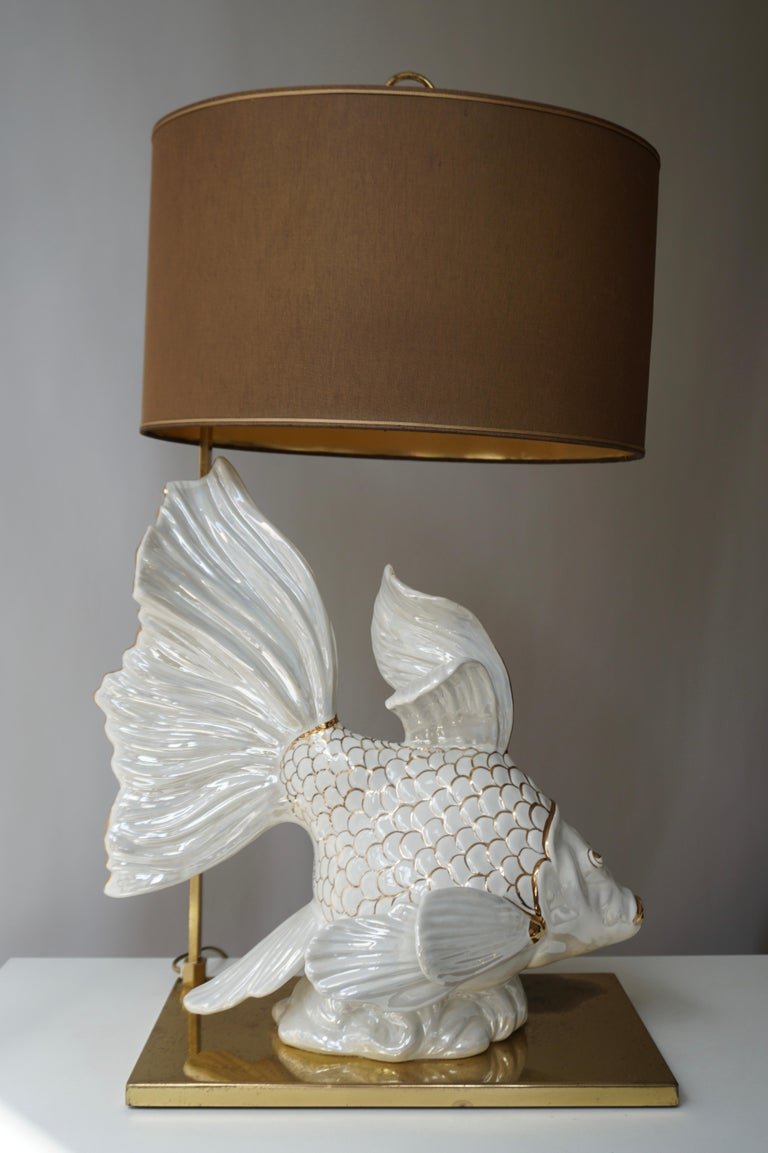 Beautiful white ceramic fish table lamp, handmade and hand painted with gold plate on a brass base.