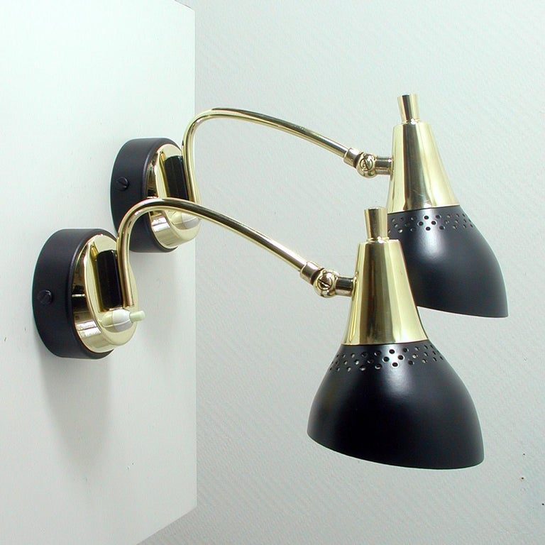 These pretty wall lights were designed and manufactured in Italy in the 1950s.