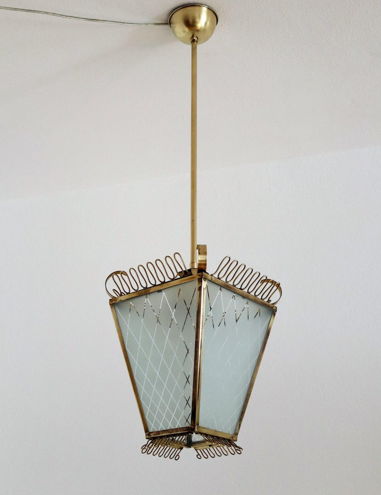 Beautiful tiny pendant lamp or lantern with handcrafted glass and brass details.