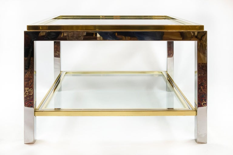 Italian Willy Rizzo midcentury brass, chrome and glass coffee table. The top and down shelve of this table are with clear glass that is inserted in brass frame. This table is very heavy.