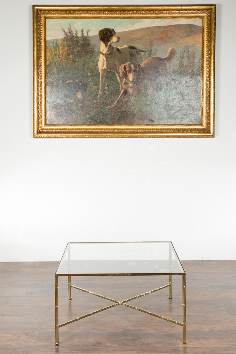 Italian Midcentury Brass Coffee Table with Glass Top and X-Form Cross Stretcher In Good Condition For Sale In Atlanta, GA