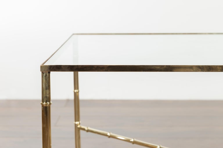 20th Century Italian Midcentury Brass Coffee Table with Glass Top and X-Form Cross Stretcher For Sale