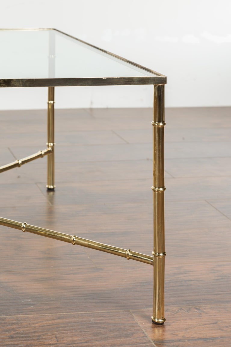 Italian Midcentury Brass Coffee Table with Glass Top and X-Form Cross Stretcher For Sale 1