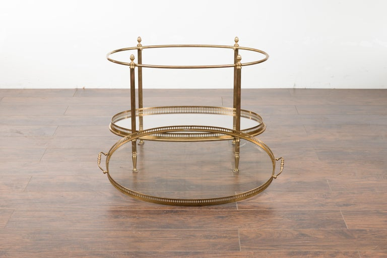 20th Century Italian Midcentury Brass Oval Side Table with Pierced Gallery and Glass Shelves For Sale