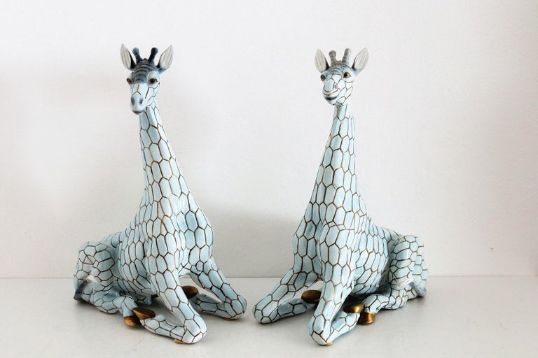 Beautiful pair of big size (40cm or 15.7inch in height) ceramic giraffes made from Giovanni Ronzan, Turin, Italy, approximately 1956/1958. Both giraffes (Male and Female) are hand painted, signed and numbered at the bottom