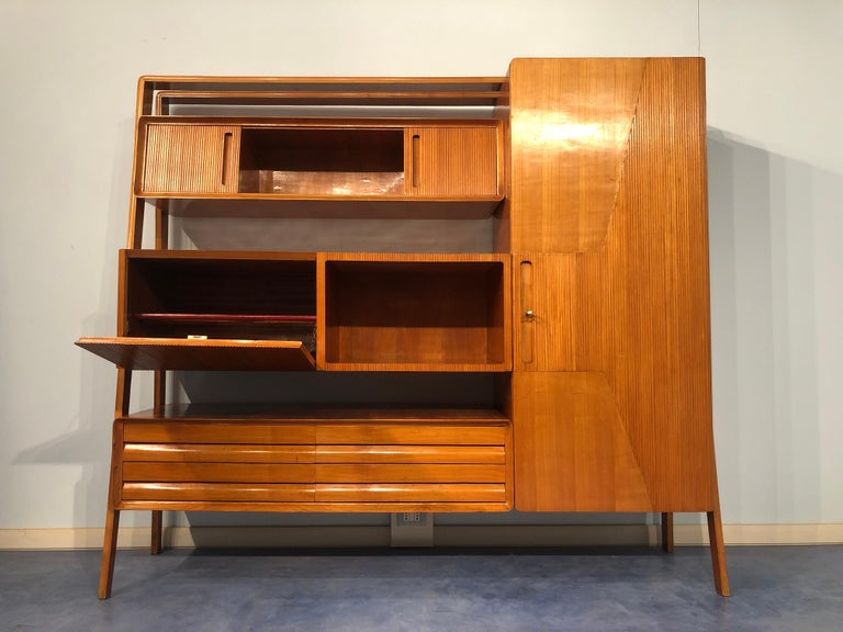 Italian sideboard in cherrywood by La Permanente Mobili di Cantù, 1950s. Warmth and elegance are typically Italian. A wonderful solution for side supports, with a refined line,