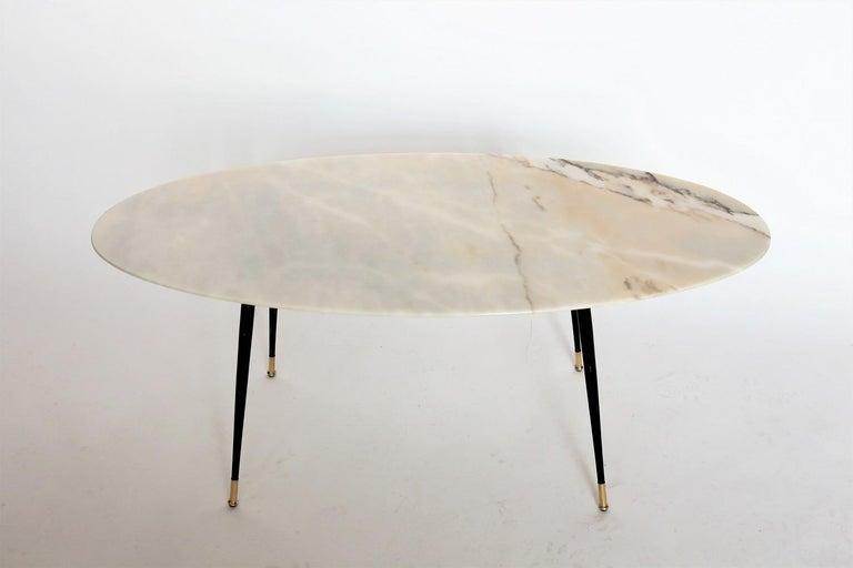 Magnificent coffee table with gorgeous elegant pink marble top and metallic legs with brass tips. Made in Italy during the 1950s. The marble is called