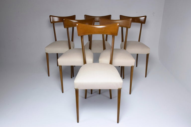 20th century vintage set of six Italian dining chairs in Ico Parisi style circa 1950s. The backrest is designed with a striking curved panel and structure highlighting timeless modernity. 