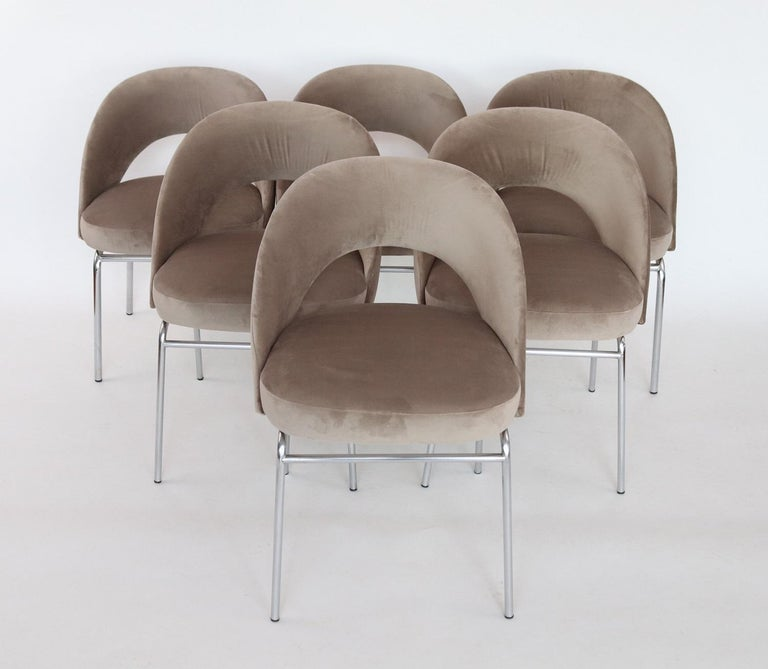 Beautiful and very comfortable set of six dining chairs with chromed base. Made in Italy during the 1960s similar to the style of Eero Saarinen chairs made by Knoll. These chairs have been completely restored internally and reupholstered with soft