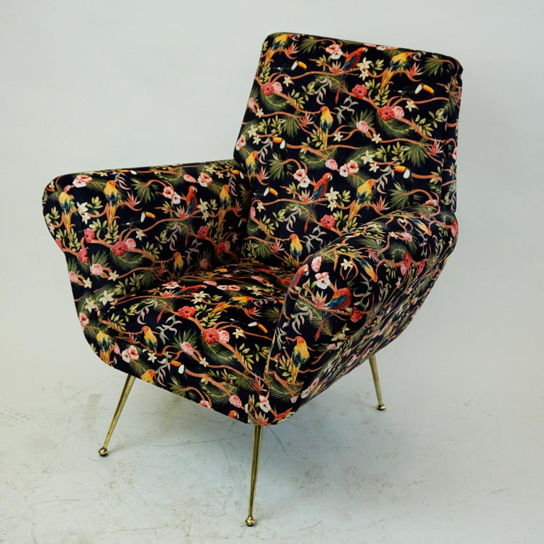 Amazing and comfortable Italian Mid-Century Modern Loungechair with new top quality black Velvet with floral ornaments and birds. It features a solid wooden frame with elegant brass legs. A perfect highlight for any Mid-Century Modern interior!