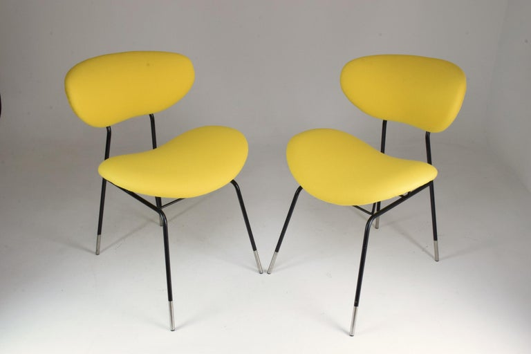 Pair of 20th century vintage chairs designed by Gastone Rinaldi for RIMA in fully restored condition, circa 1950s. The chairs are highlighted by their extreme comfort and small size. 