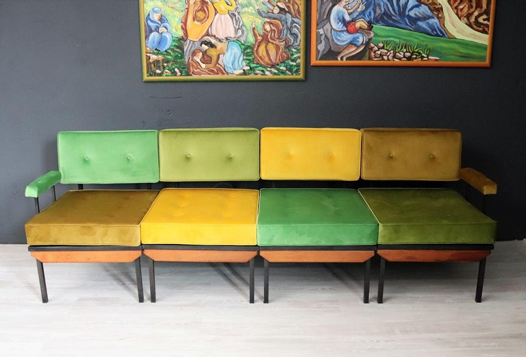 Gorgeous colorful sofa made in Italy in the 1960s. The sofa is composed of 4 seating elements, which can be used also singularly. The are made of a metal frame with 1 wooden detail in front. Two elements are equipped with armrests. The basic