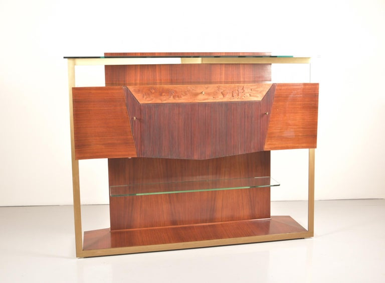 Spectacular rosewood sideboard and/or bar cabinet designed by Vittorio Dassi in the 1950s.