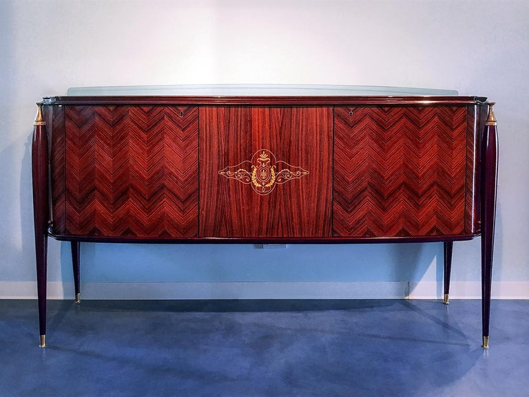 Stunning small Sideboard, very rare and attributable to the design of Paolo Buffa in the 1950s. It has a unique design, very stylish and charming, characterized by structure made in rosewood, with tapered legs finished with fine brass