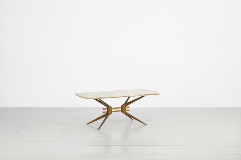 Side table, Italy, 1960s. The simple coolness of the metal frame with its technical forms contrasts the vivid structures in the onyx tabletop. The metal frame can be disassembled.  You may find the second table on 1st dibs with the following