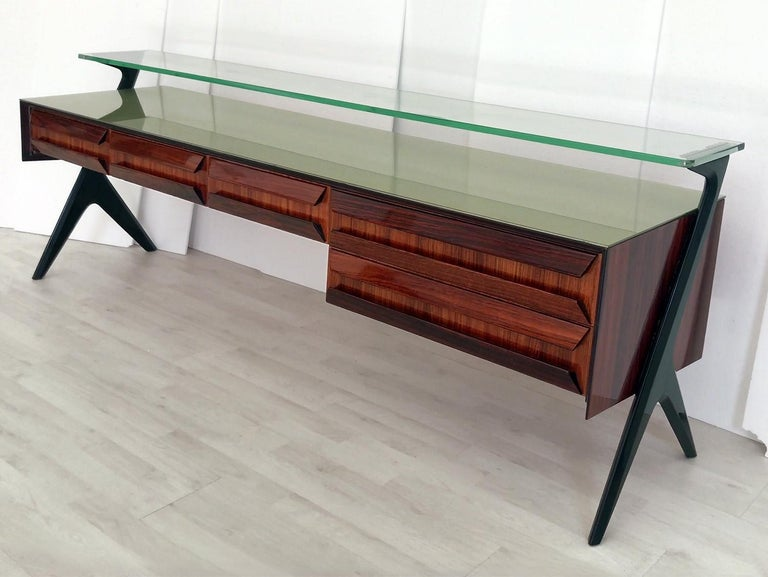 Stunning Sideboard and/or Vanity dresser designed by Vittorio & Plinio Dassi in the 1950s. Its aesthetic uniqueness is given by the original sculptural shape design of the drawers and lateral supports, in addition with the top green glass