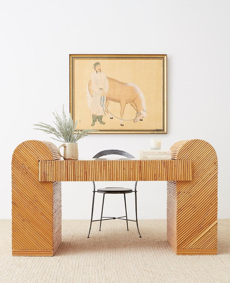 Exceptional Italian Mid-Century Modern three-piece writing table or desk. Constructed from a wooden frame crafted with split reed bamboo rattan. This desk represents everything wonderful about the use of rattan. Incredible geometric patterns abound