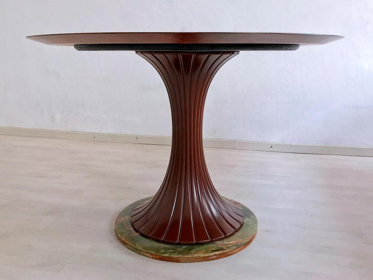 Dining table well designed by Vittorio Dassi in the 1950s, very stylish and charming as all the items manufactured by him. The round tabletop is teak wood and its base made of precious green Pakistan onyx, rare stone chosen by the most important