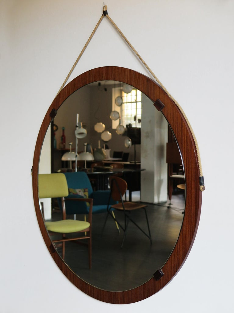 Very large Italian Mid-Century Modern design wood wall mirror designed by Franco Campo & Carlo Graffi for Home with round frame wood, 1950s