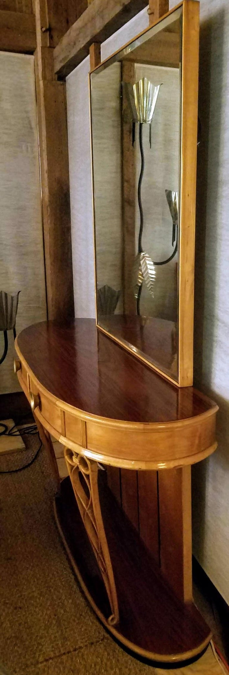 Italian mirrored console from the Florentine studio of Atilio Fagioli dating from the 1940s. Stylized arabesques of ice cream cone supports of cared maple provide calligraphic decoration to this neoclassical piece executed in Rosewood and Amboyna