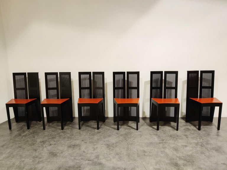 Set of 6 vintage high back 'Lubekka' dining chairs designed by Andrea Branzi for Cassina.  Produced from 1991-1999.  Made from ebony stained ash wood and upholstered with Bulgarian red leather.  Good condition with normal signs of
