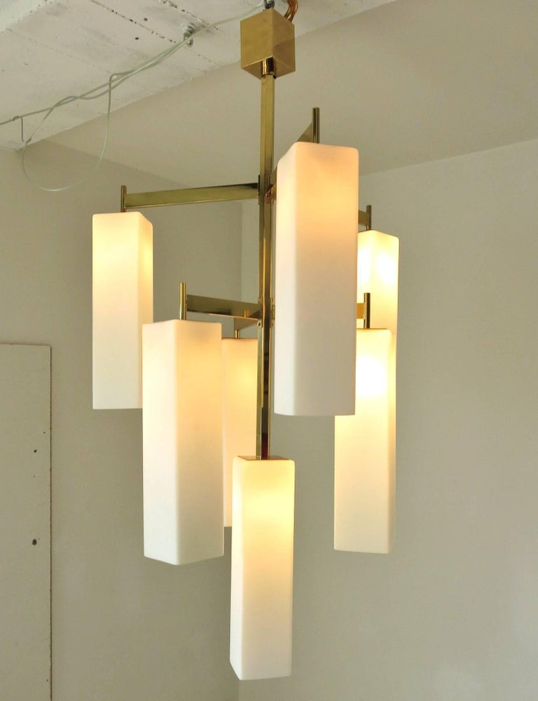 Italian modern chandelier with frosted white rectangular Murano glass shades, mounted on polished brass frame / Made in Italy 2017.