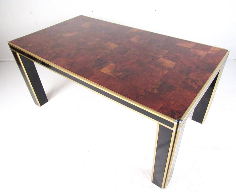 Impressive vintage modern table features metal frame with parquet burl wood top. Heavy lacquer finish adds to the stylish modern elegance of this large desk or table, while two-tone black and brass finish compliments the Italian Regency style.