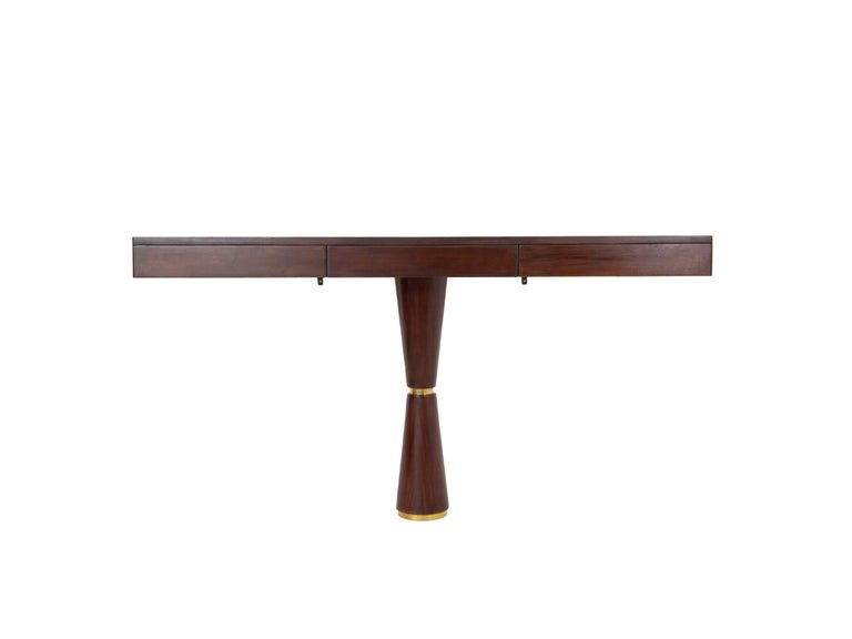 Absolutely stunning Italian Modern console in hard wood and brass attributed to Angelo Mangiarotti from the 1960s. It has three drawers with blind handles. The cone has a brass middle and bottom decoration. It has two small hooks to mount this