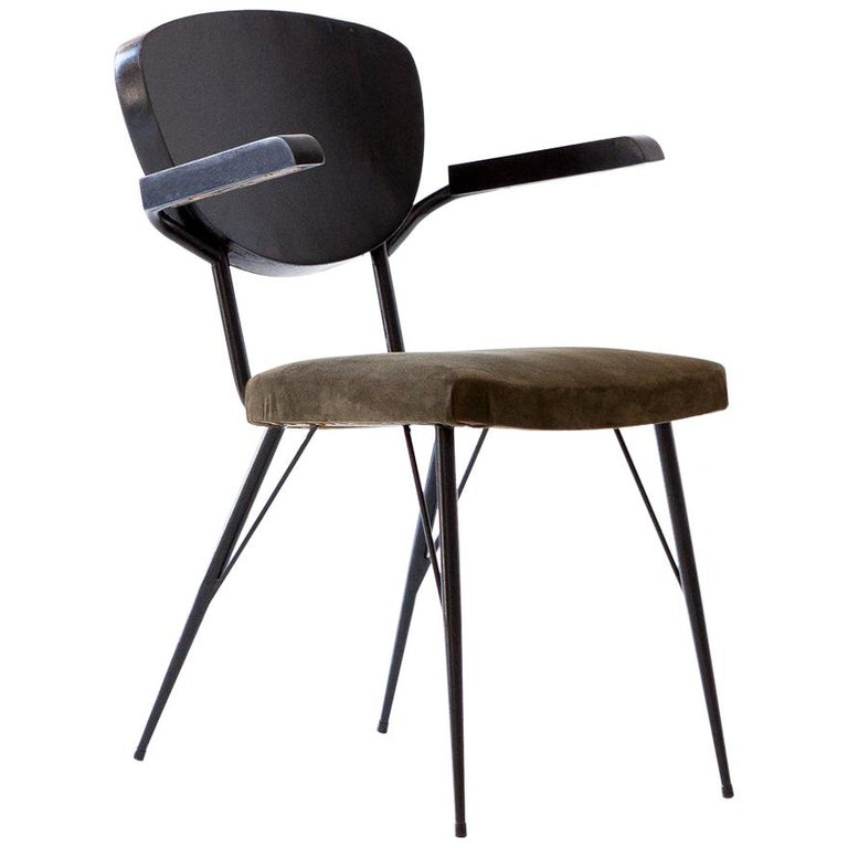 Set of six Mid-Century Modern dining chair manufactured in Italy in the 1950s   Black enameled wood, black enameled iron and new olive green natural suede leather Each chair is completely restored but you can still see natural signs of age