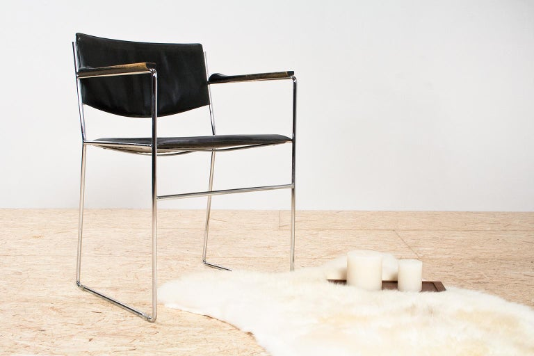In style with the modernist designs of Marcel Breuer, Giovanni Carini, Mies Van Der Rohe, this is a beautiful and elegant chair. Elegant thin metal tubing is combined with luxury, thick leather seat and wooden armrest. The chair is in good vintage