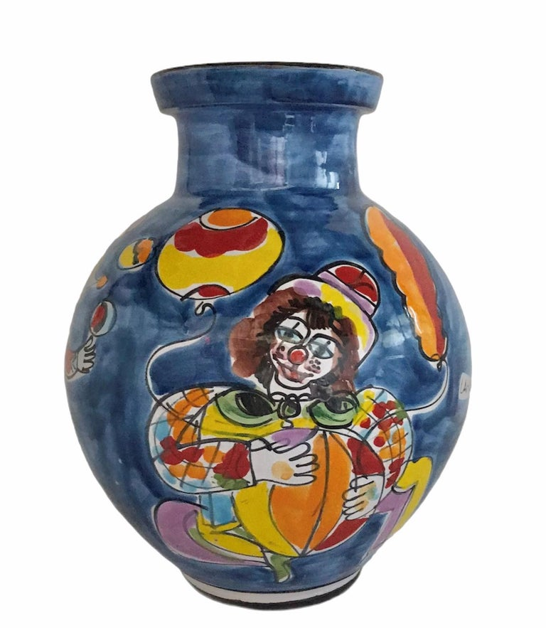 La Musa large bulbous ceramic floor vase 1970s Italian Modern, Carnevale, produced for Saks Fifth Avenue. The colorful design is of Circus or Carnival characters - clown, juggler, musician and acrobats. Saks Fifth Ave foil label remains on base of