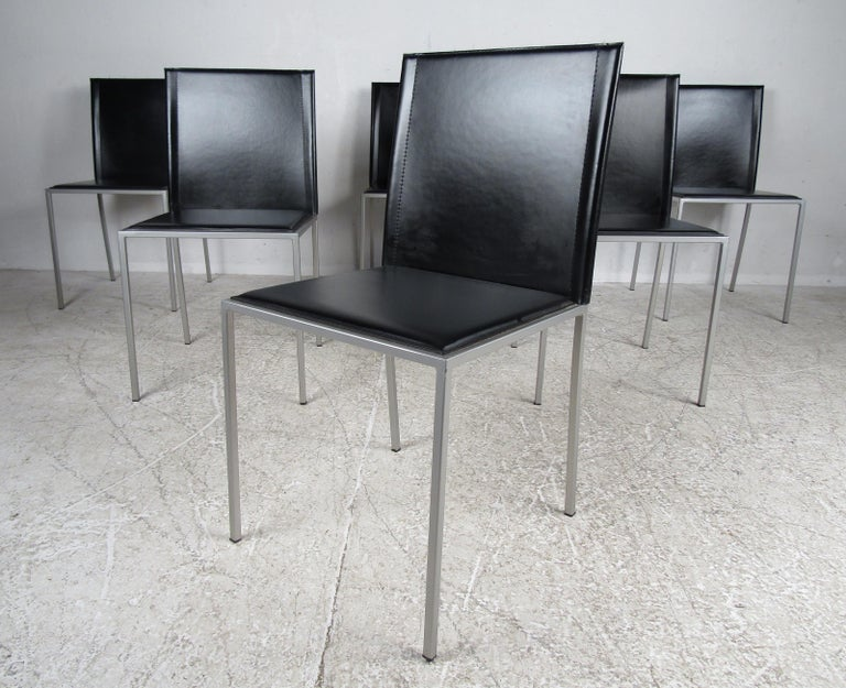 Midcentury style set of six Italian dining chairs featured in black leather and aluminum frame. This set of chairs would make a great addition to any home or office.  Please confirm the item location (NY or NJ).