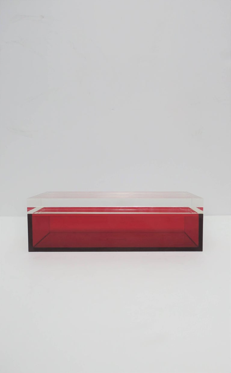 A beautiful Italian Postmodern, Modern or Minimalist style rectangular designer box by Alessandro Albrizzi, circa 2005. Box is a translucent red acrylic and a thick clear Lucite top. Designer's mark