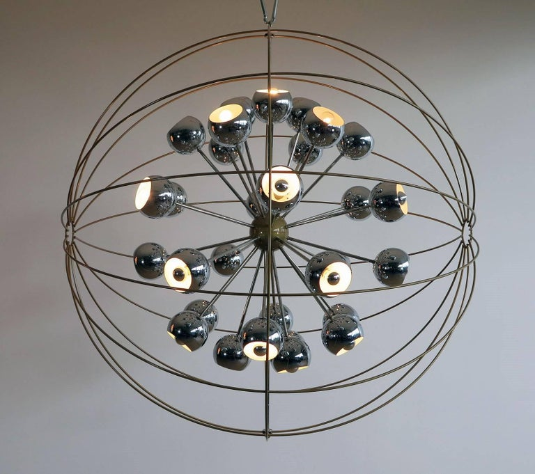 Unique creation with 30 original Reggiani chrome eyeball lamps, like a stars in the space, rounded with a metal frame. We can wire for US standards, 30 E27 lamp bulbs.