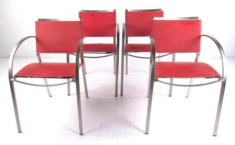 Stylish set of four leather and metal frame armchairs which would compliment any modern or midcentury setting. Please confirm item location (NY or NJ) with dealer.