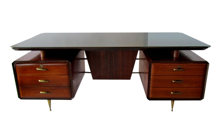 An exceptional desk by Melchiorre Bega (1898-1976), Italian architect and designer, from a long line of cabinet makers. You can tell he paid attention by the details in this piece. Constructed of rosewood, mahogany, glass and bronze, the modern