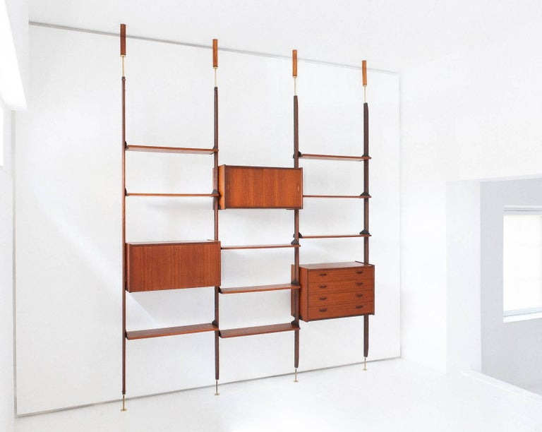 Bookshelf/wall unit Italian design 1950s Teak, iron, brass  Completely restored  The height is adjustable, just specify your ceiling height for a confirmation  The wooden support to the ceiling is just for the pictures  Worldwide shipment